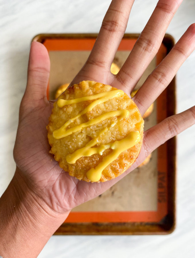 Mango cheesecake hand pies with mango drizzle
