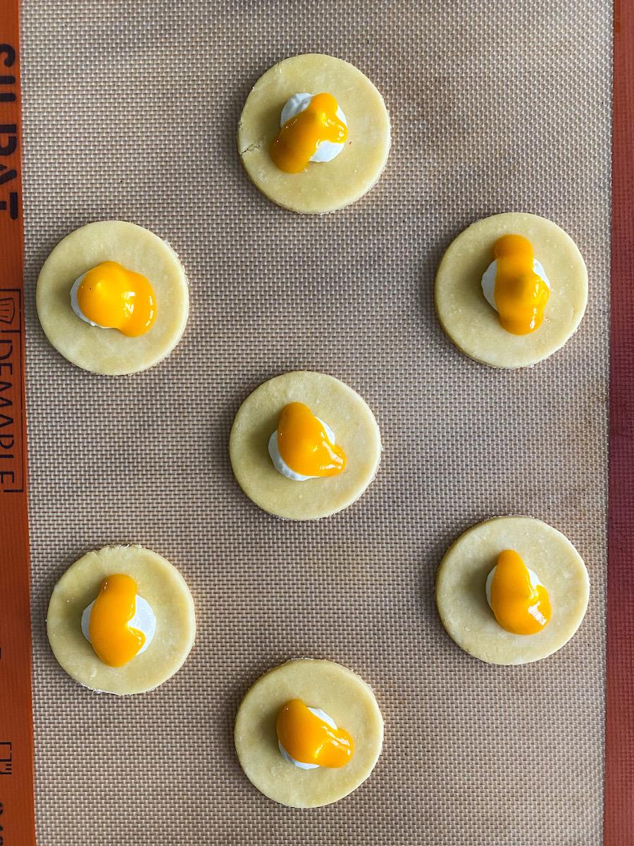 assembling mango cheesecake hand pies