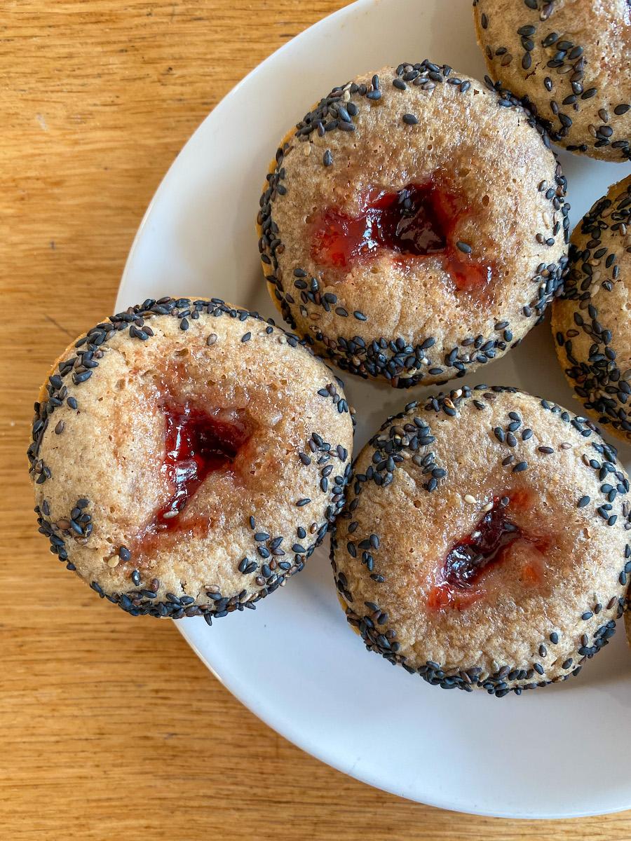 tahini rye muffins on a plate